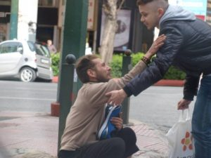 man giving new blue shoes to another man