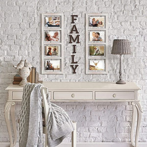 a white table below to sets of family portraits with the words family between them