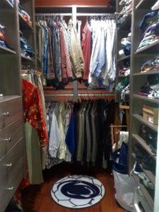 a penn state rug in a full closet