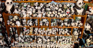 a packed closet full of stuffed pandas