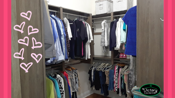 clothes hanging in custom walk in closet