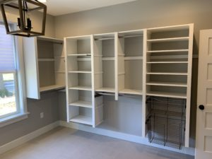 empty white hanging closet shelving