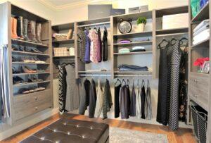 organized custom closet with hanging wardrobe